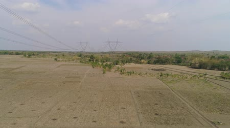 パイロン : Electricity pylons bearing power supply across rural landscape. aerial view power pylons and high voltage lines java, indonesia.High voltage metal post, tower. Electric Power Transmission Lines over t