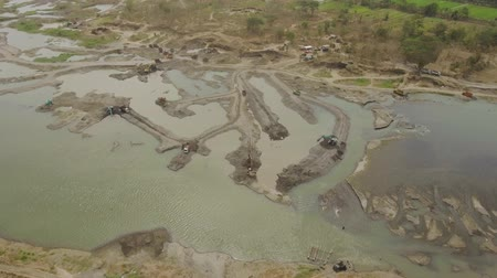 Łopata : Aerial view excavator and heavy equipment, dredging and deepening the channel mountain river. Heavy dredging machine on river bank. Excavator dredge river. java, indonesia Wideo