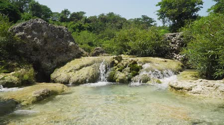 luzon : Waterfall in green rainforest. Bolinao waterfall in the mountain jungle. Philippines, Luzon. Travel concept.