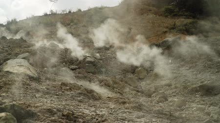 kükürt : plateau with geothermal volcanic activity, geysers. volcanic landscape Dieng Plateau, Indonesia. Famous tourist destination of Sikidang Crater it still generates thick sulfur fumes.