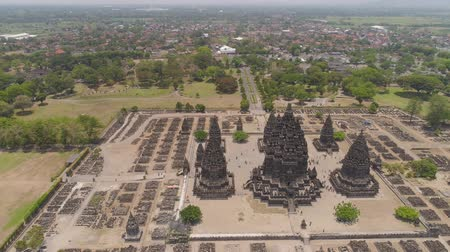 резной : aerial view hindu temple Candi Prambanan in Indonesia Yogyakarta, Java. Rara Jonggrang Hindu temple complex. Religious building tall and pointed architecture Monumental ancient architecture, carved stone walls. Стоковые видеозаписи