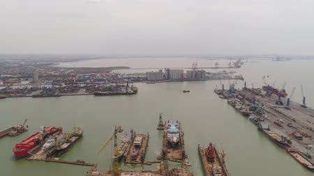 container terminal : aerial view cargo and passenger seaport with ships and crane Tanjung Perak, surabaya, indonesia. docks for the repair and parking of ships, cargo port and container terminal. ship in industrial port