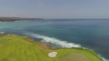 curso : aerial view golf course on cape against ocean. golf course on tropical island on coastline.