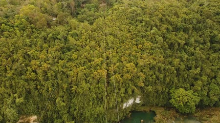 zipline : aerial view people using zipline attraction over river Loboc. People doing zip line Bohol, Philippines Travel concept. Aerial footage. Stock Footage