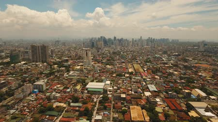 manilla : aerial footage Manila city with skyscrapers and buildings Philippines. Modern city by sea, highway, cars, skyscrapers, shopping malls Makati district Travel concept.