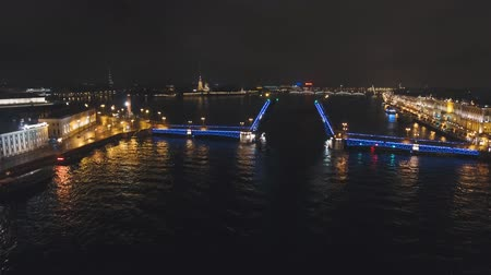 aziz : Aerial view Bridge with illumination. City night scene with illuminated drawbridge over river.Saint Petersburg,Russia. Stok Video