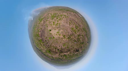 valley of fire : little planet view landscape mountains slopes volcano with fire, farmland at foot of the volcano Agung Aerial view of Mountains are covered with forest. Bali, Indonesia. Stock Footage