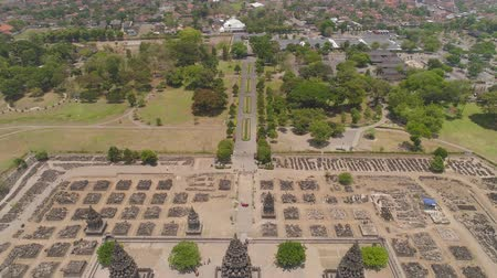 monumentális : aerial view hindu temple Candi Prambanan in Indonesia Yogyakarta, Java. Rara Jonggrang Hindu temple complex. Religious building tall and pointed architecture Monumental ancient architecture, carved stone walls. Stock mozgókép