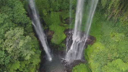 ztrojnásobit : waterfall in green rainforest. Aerial view triple tropical waterfall Sekumpul in mountain jungle. Bali,Indonesia. Travel concept. Aerial footage.
