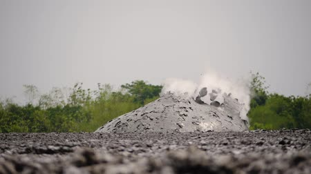 geológiai : mud volcano with bursting bubble bledug kuwu. volcanic plateau with geothermal activity and geysers, slow motion Indonesia java. volcanic landscape