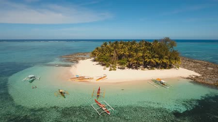 siargao island : Aerial footage sand beach and palm trees on tropical island with turquoise sea. tropical seascape Siargao, Philippines Tropical landscape ocean, sky, sea