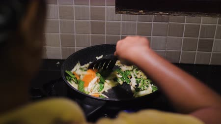 vegetable wok : stir fried vegetables in pan. Vegetarian eating preparing vegetables meal in cooking pan Stock Footage