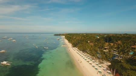 costa azzurra : aerial footage beautiful sandy beach with tourists, hotels and palm trees Alona beach, Panglao Philippines Seascape ocean, sky, sea Travel concept Filmati Stock