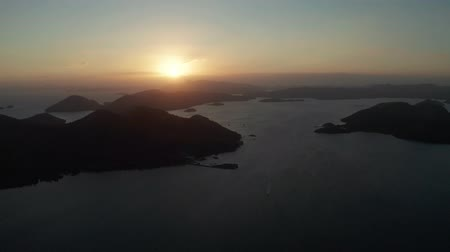 dark island : aerial view sunset over the sea with islands. Philippine Islands in the evening. Busuanga, Palawan, Philippines Stock Footage