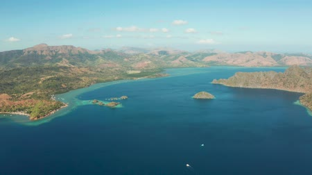 cristal : Aerial tropical landscape, lagoon with blue water and mountains of tropical island .lagoons and coves with blue water among the rocks. lagoon, mountains covered with forests. Seascape, tropical landscape. Palawan, Philippines, Coron