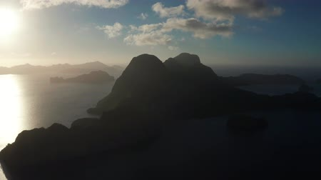kalker : Aerial drone seascape with mountains and rocky islands in the morning time El Nido.. tropical bay in at sunset. Sunset sky and mountains rocks of bay. Dreamy sunset among the rocks.