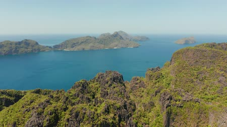palawan : aerial view of bay and the tropical islands. Seascape with tropical rocky islands, ocean blue water. islands and mountains covered with tropical forest. El nido, Philippines, Palawan. Tropical Mountain Range
