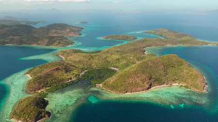 white sand : aerial view tropical islands with blue lagoon, coral reef and sandy beach. Palawan, Philippines. Islands of the Malayan archipelago with turquoise lagoons. Stock Footage