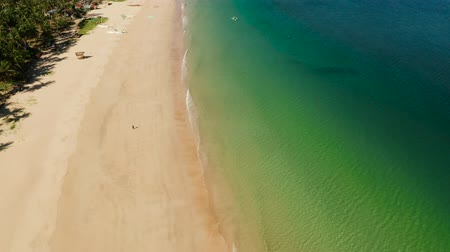 philippine : Aerial drone blue sea and tropical beach. Nacpan, El Nido, Palawan, Philippine Islands. Seascape with tropical beach and islands. Summer and travel vacation concept Stock Footage