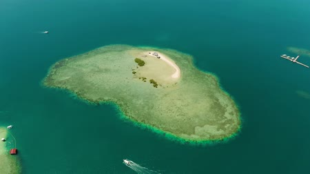 tartaruga : Sandy island with sand bar surrounded by coral reef and blue sea in honda bay, aerial drone. Coral atoll with a sandy beach. Summer and travel vacation concept, Philippines, Palawan