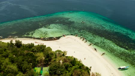 island hopping : Sandy beach on tropical island surrounded by coral reef, top view. Mantigue island. Small island with sandy beach. Summer and travel vacation concept, Camiguin, Philippines, Mindanao