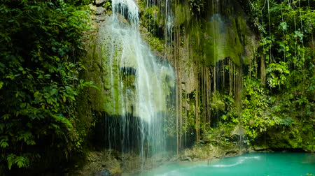 cebu : Aerial view of Cambais waterfalls in a mountain gorge in the tropical jungle, Philippines, Cebu. Waterfall in the tropical forest.