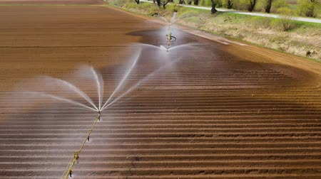 water sprayer : aerial view Center pivot agriculture irrigation machine of crops. An irrigation pivot watering agricultural land. Irrigation system watering farm land.