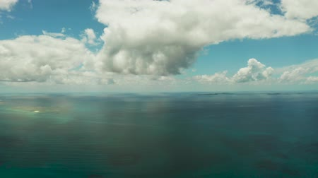 siargao island : Cloud landscape : Blue sky with clouds over the sea with islands top view. Summer and travel vacation concept. Stock Footage