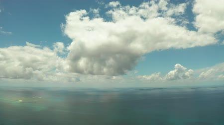 grande : Seascape: Blue sky with clouds over the sea with islands, aerial view. Summer and travel vacation concept.