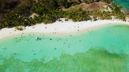island hopping : aerial seascape tourists enjoy tropical beach. tropical island with sand beach, palm trees. Malcapuya, Philippines, Palawan. Tropical landscape with lagoon, coral reef