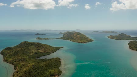 Океания : aerial view small island group in province of Palawan. Busuanga, Philippines. Seascape, islands covered with forest, sea with blue water. tropical landscape, travel concept