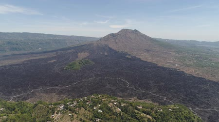 nuvem : Aerial view landscape after volcanic eruption volcano Batur mountain landscape with volcano sky and clouds Bali, Indonesia. Travel concept. Aerial footage. Stock Footage