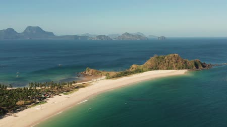philippine : Aerial view of tropical island with sandy beach. Nacpan, El Nido, Palawan, Philippine Islands. Seascape with tropical beach and islands. Summer and travel vacation concept