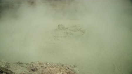 vulkán : mud volcano Kawah Sikidang, geothermal activity and geysers. plateau Dieng with volcanic activity Indonesia. Famous tourist destination of Sikidang Crater it still generates thick sulfur fumes.
