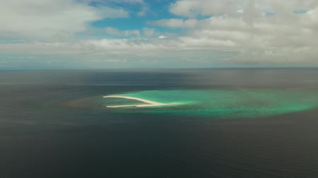 mindanao : Tropical white island and sandy beach with tourists surrounded by coral reef and blue sea, aerial view. Sandbar Atoll. Island with sand bar and coral reef. Summer and travel vacation concept, Camiguin, Philippines. Stock Footage