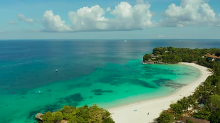 boracay : Sandy beach with blue water at a tropical resort aerial view, Boracay, Philippines. Seascape with beach on tropical island. Summer and travel vacation concept.