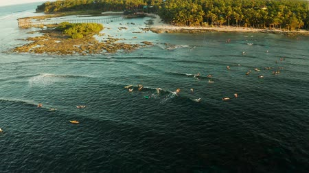 luna : Surfers on the waves in the place of cloud 9 on the island of Siargao, the famous surf spot from above. Stock Footage