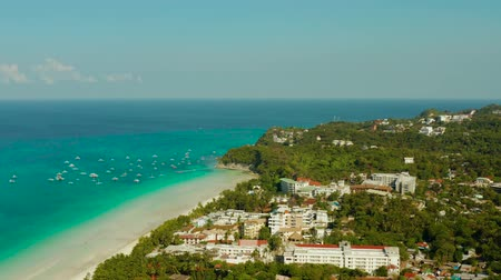 boracay : Tropical beach with tourists and clear blue sea, top view. Summer and travel vacation concept. Boracay, Philippines
