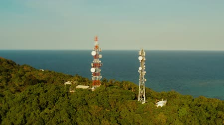 alıcı : Telecommunication tower, communication antenna in tropical island aerial view. Repeaters on a metal tower. Boracay, Philippines