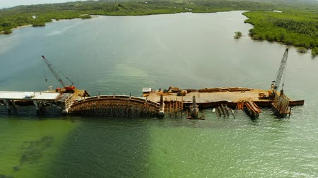 pilíře : Bridge under construction over the sea bay connecting the two parts of Siargao island.