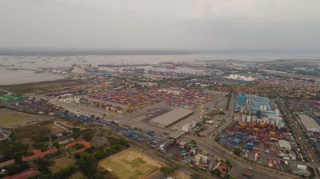 eksport : aerial view container terminal port surabaya. cargo industrial port with containers, crane. Tanjung Perak, indonesia. logistic import export and transport industry Wideo