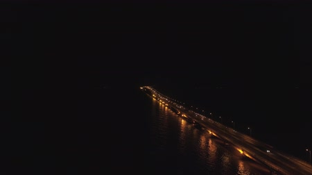 ponte sospeso : aerial view lighted bridge at night with highways and cars. suspension bridge over madura strait with highway and car, surabaya. aerial view bridge Suramadu connecting islands Java and Madura. High coast bridge with highway.java, indonesia