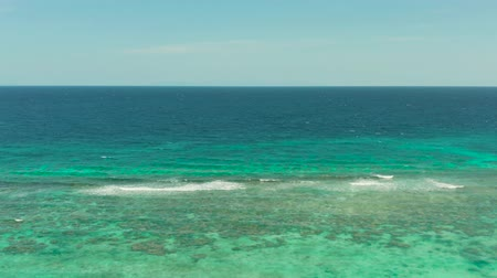 filipíny : Sea water surface in lagoon, copy space for text, aerial view. Top view transparent turquoise ocean water surface. background texture Dostupné videozáznamy