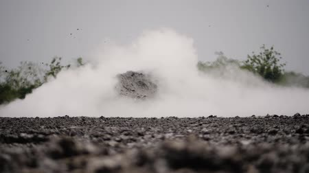 извержение : mud volcano with bursting bubble bledug kuwu. volcanic plateau with geothermal activity and geysers, slow motion Indonesia java. volcanic landscape