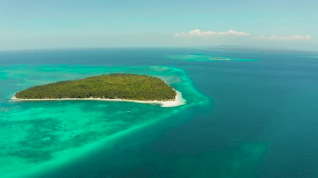 balabac : Tropical island with sandy beach by atoll with coral reef and blue sea, aerial view. Patongong Island with sandy beach. Summer and travel vacation concept.