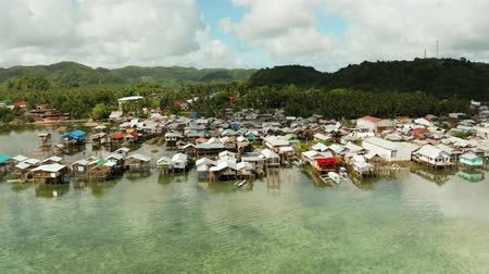 навес : Village of stilt houses built over the sea, top view. Dapa, Siargao, Philippines.