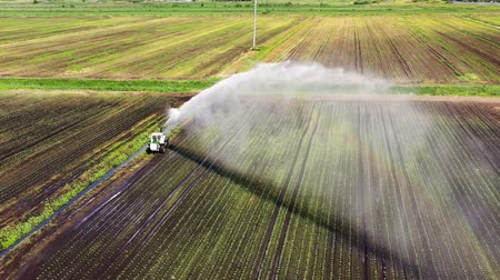 water sprayer : Center pivot agriculture irrigation machine of crops aerial view. An irrigation pivot watering agricultural land. Irrigation system watering farm land.