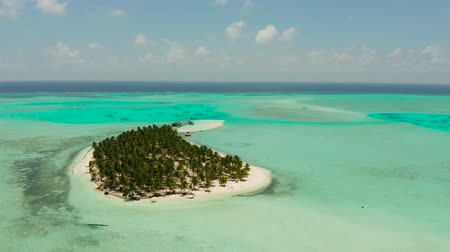 balabac : Travel concept: sandy beach on a tropical island by coral reef atoll from above. Onok Island, Balabac, Philippines. Summer and travel vacation concept