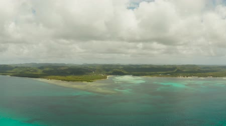 siargao : The tropical island of Siargao, covered with green forest and jungle in cloudy weather with clouds.