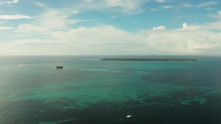 naga : Blue sea with atoll and coral reef, islands under the sky with clouds, top view. Summer and travel vacation concept. Siargao,Philippines. Wideo